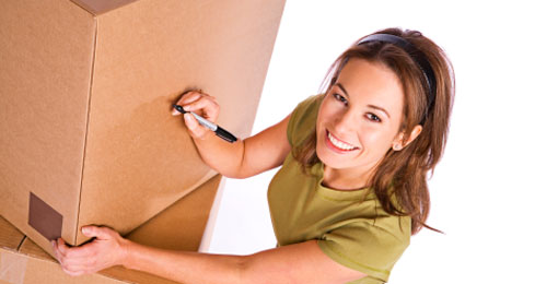 woman packing boxes for storage